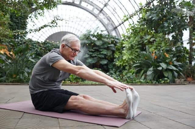 passive stretching_man doing seated forward fold